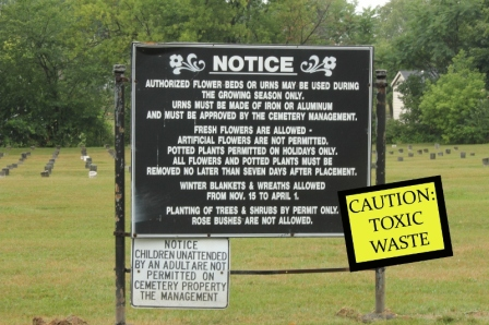 Cemetery sign with toxic waste warning (800x533)