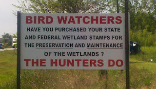 sign about birders purchasing federal wetlands stamps