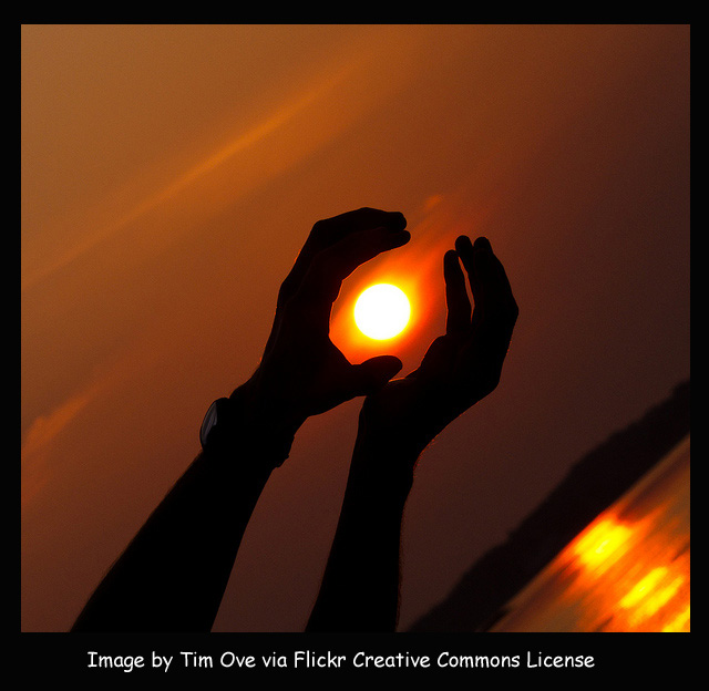 Reaching hands and sun via Flickr by timove with frame and caption