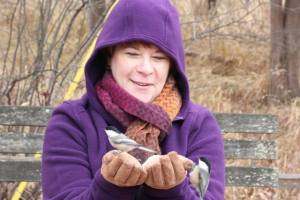 Kim with two chickadees in hand at Kensington Dec 2014