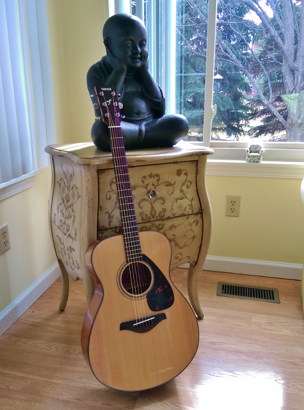guitar and monk statue in sunroom (594x800)