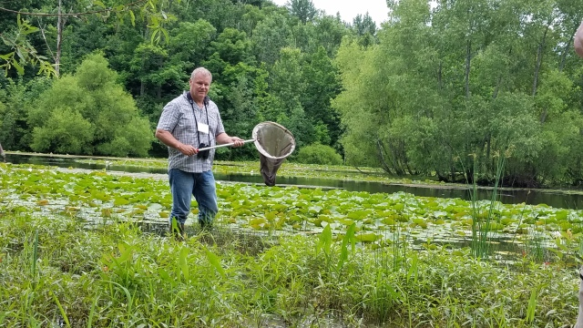 Jim McCormac with net in pond