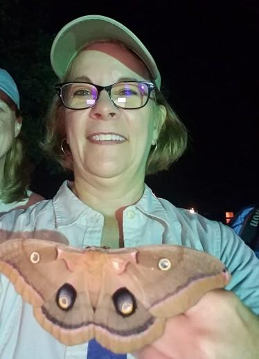 Kim holding polyphemus moth